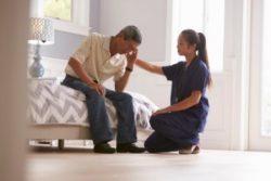 Nurse comforting man